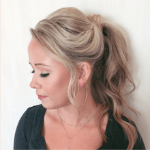 Blond haired client showing off her haircut seen from the side
