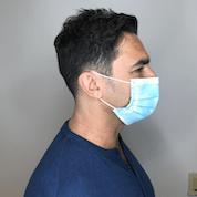 Profile shot of a man wearing a protective face mask