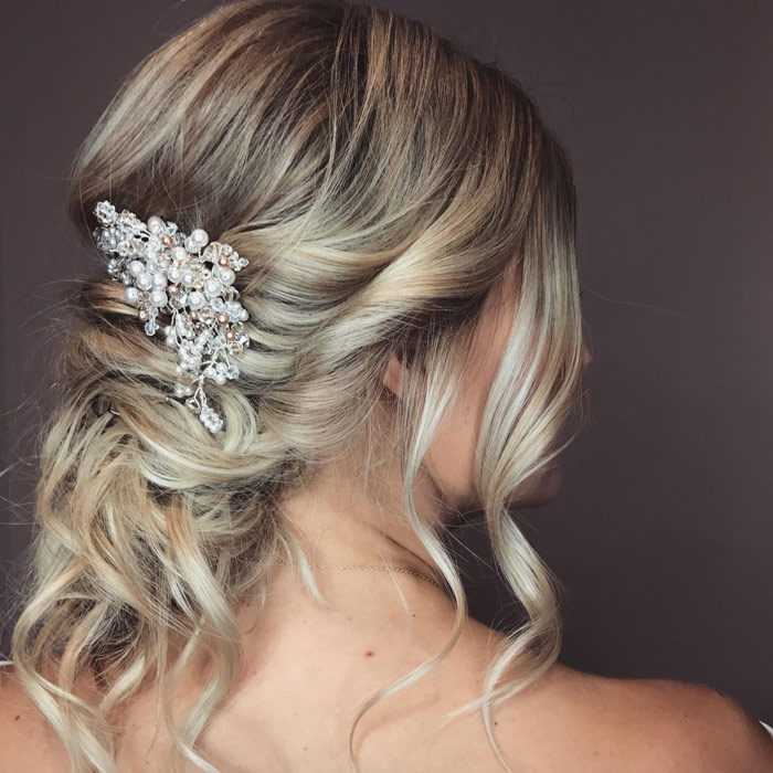 Intricate Wedding/Bridal Hairstyle with a pearl hairpiece done at Fortelli Salon & Spa
