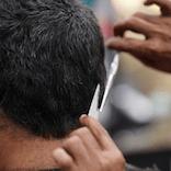 Detail of a man getting a haircut