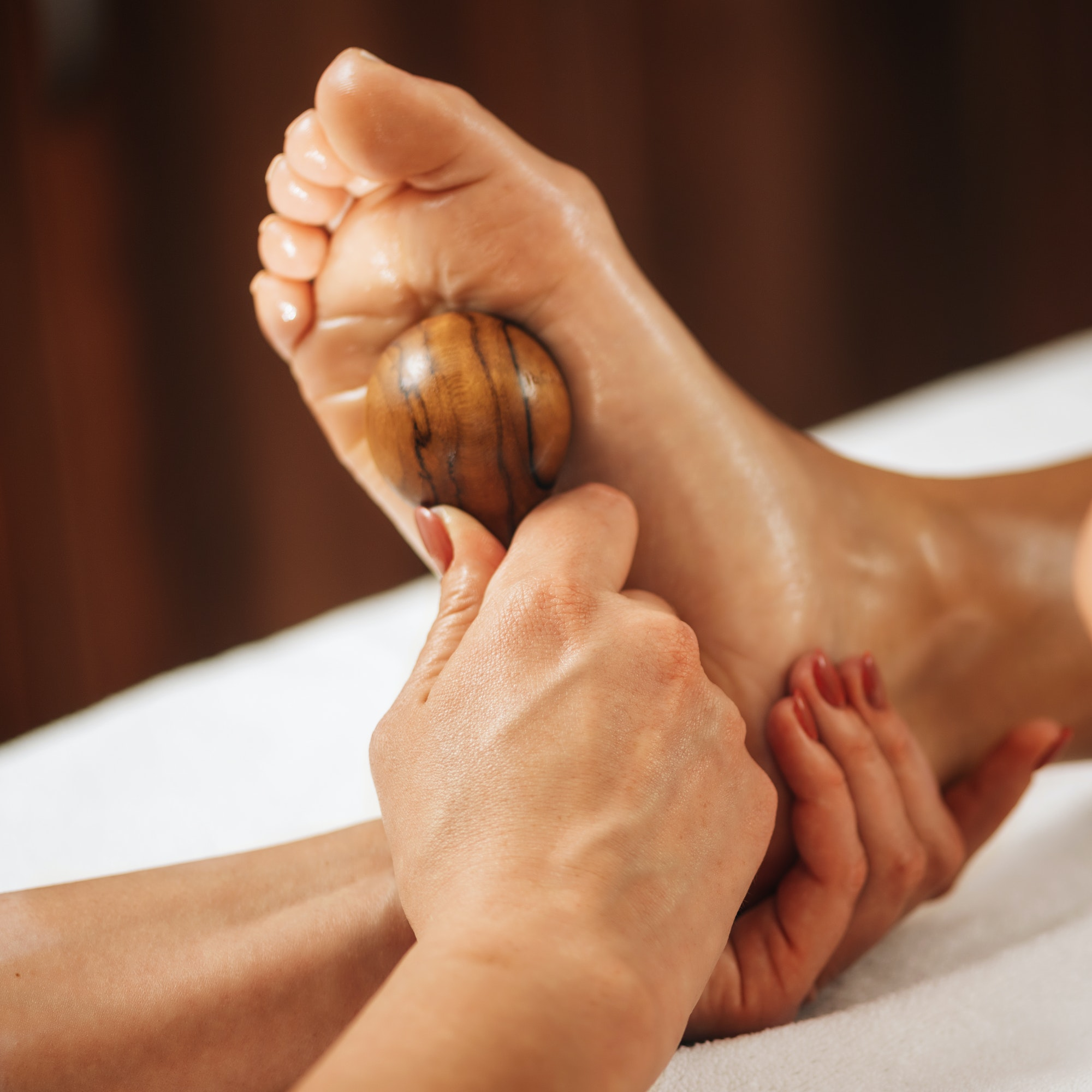Reflexology - Foot Massage with Wooden Massage Tool.