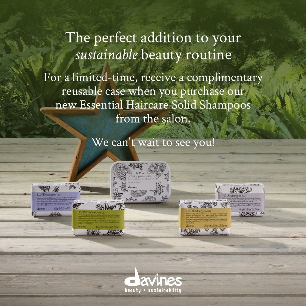 advertisement for Davines beauty products featuring a set of solid shampoo blocks on a wooden deck with a wooden star behind